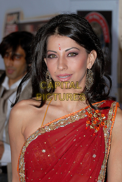 GUEST.The Zee Cine Awards, Excel Centre, London, England..April 26th 2008.headshot portrait bindi red one shoulder  earrings gold trim corsage .CAP/IA.©Ian Allis/Capital Pictures.