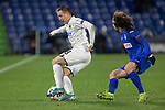 GETAFE, SPAIN - DECEMBER 12: FC Krasnodar's Sergey Petrov and Getafe CF's  Marc Cucurella in action during the UEFA Europa League group C match between Getafe CF and FK Krasnodar at Coliseum Alfonso Perez on December 12, 2019 in Getafe, Spain. <br /> (ALTERPHOTOS/David Jar)