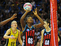 Mwai Kumwenda shoots for goal during the ANZ Netball Championship match between the Central Pulse and Mainland Tactix at Te Rauparaha Arena, Wellington, New Zealand on Saturday, 11 May 2015. Photo: Dave Lintott / lintottphoto.co.nz