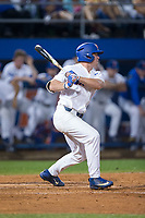 Deacon Liput (8) of the Florida Gators follows through on his swing against the Wake Forest Demon Deacons in Game One of the Gainesville Super Regional of the 2017 College World Series at Alfred McKethan Stadium at Perry Field on June 10, 2017 in Gainesville, Florida.  The Gators defeated the Demon Deacons 2-1 in 11 innings.  (Brian Westerholt/Four Seam Images)