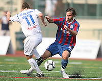 Santiago Fusilier #21 of Crystal Palace Baltimore clashes with Leonardo DiLorenzo #11 of the Montreal Impact during an NASL match at Paul Angelo Russo Stadium in Towson, Maryland on August 21 2010. Montreal won 5-0.