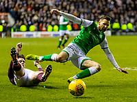3rd March 2020; Easter Road, Edinburgh, Scotland; Scottish Premiership Football, Hibernian versus Heart of Midlothian; Jamie Walker of Hearts brings down Martin Boyle of Hibernian