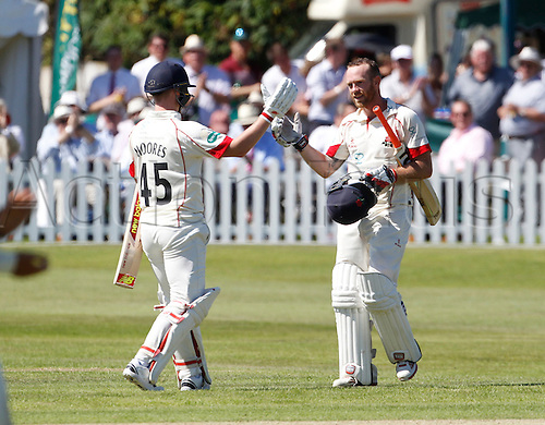 18.07.2016. Southport and Birkdale Cricket Club, Southport, England. Specsavers County Championship Cricket. Lancashire versus Durham. Lancashire all-rounder Luke Proctor is congratulated by Lancashire wicket-keeper Tom Moores after completing his second first class century during the second session's play with Lancashire slowly building a lead.