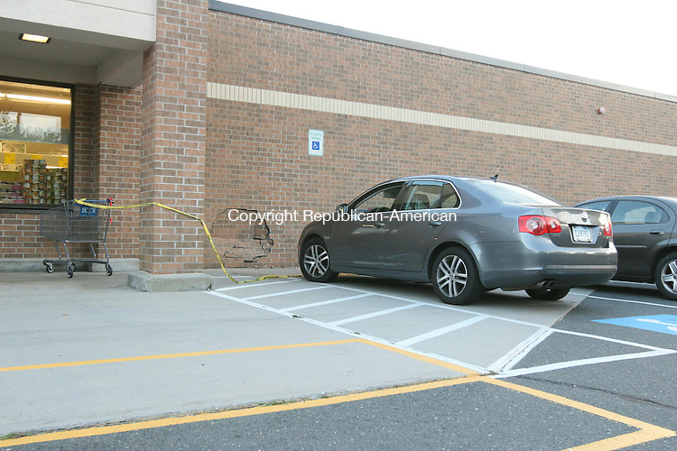 TORRINGTON, CT - 18 September, 2010 - 091810MO01- Torrington police said the 68-year-old city woman who was at the wheel of a Volkswagen Jetta that dented the brick wall of the Aldi grocery store on East Elm Street blamed mechanical trouble for the crash reported at 6:24 p.m. Saturday. Jim Moore Republican-American.