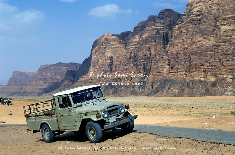 Run down four wheel drive parked in the desert, Wadi Rum, Jordan.