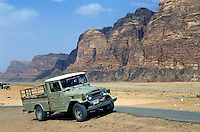 Run down four wheel drive parked in the desert, Wadi Rum, Jordan.