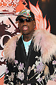 Coach Dennis Rodman pose for a photo at the press conference for HQ's strippers basketball team in New York, on Thursday, Mar. 01, 2012. (AP Photo/ Donald Traill)