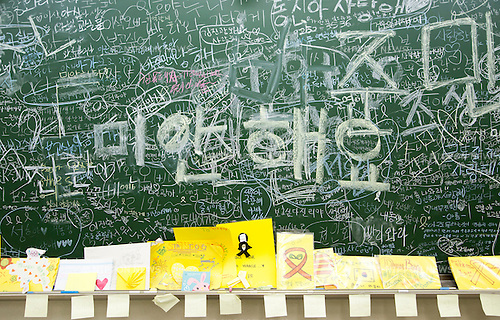 Sewol Ferry Disaster, May 22, 2016 : Messages to offer condolences for the students and teachers who died in the Sewol ferry disaster in 2014, are seen on a blackboard in a classroom of Danwon High School in Ansan, south of Seoul, South Korea. The bereaved families of the student victims recently agreed with other parents at the school to move the classrooms of the victims to a permanent commemorative classroom out of the school instead of leaving them unused. The classrooms at the school have been preserved the way they were since the Sewol ferry sank in waters off the country's southwestern coast on April 16, 2014, leaving 304 people dead. Most of the victims were the students from the school on a field trip to Jeju island. (Photo by Lee Jae-Won/AFLO) (SOUTH KOREA)
