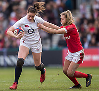 England Women's Emily Scarratt evades the tackle of Wales Women's Hannah Jones<br /> <br /> Photographer Bob Bradford/CameraSport<br /> <br /> 2020 Women's Six Nations Championship - England v Wales - Saturday 7th March 2020 - The Stoop - London<br /> <br /> World Copyright © 2020 CameraSport. All rights reserved. 43 Linden Ave. Countesthorpe. Leicester. England. LE8 5PG - Tel: +44 (0) 116 277 4147 - admin@camerasport.com - www.camerasport.com