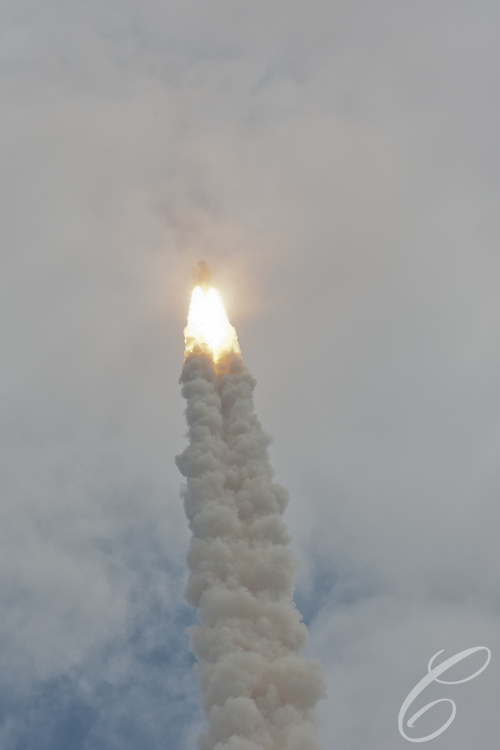 Space Shuttle Atlantis disappears from view and into the clouds for the final time on Friday, July 8, 2011.  Atlantis' mission is the final one of the shuttle program's 30 year history and leaves NASA without manned spaceflight launch capability.