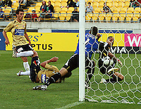 Leo Bertos pokes the ball past Jets keeper Ante Covic to score Phoenix' first goal during the A-League match between Wellington Phoenix and Newcastle Jets at Westpac Stadium, Wellington, New Zealand on Sunday, 4 January 2009. Photo: Dave Lintott / lintottphoto.co.nz