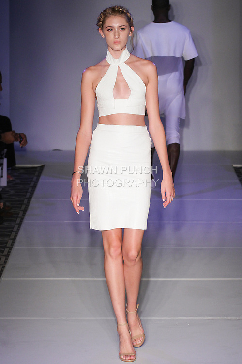 Model walks runway in an outfit from the Garcia Couture Spring Summer 2016 collection by Caroline Garcia, at the Emerging Designer's Spring 2016 fashion show, for Fashion Gallery NYFW, during New York Fashion Week Spring 2016.