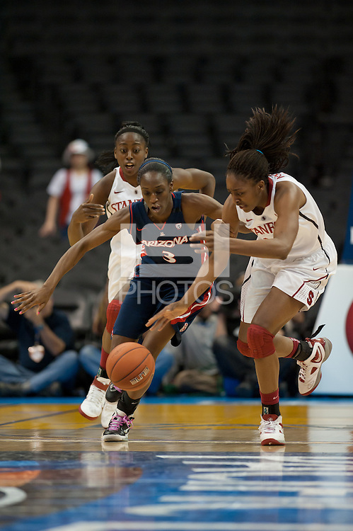 LOS ANGELES, CA - March 11, 2011:  Stanford's Nnemkadi Ogwumike chases down a loose ball during the semi-final game of the 2011 Pac-10 Tournament game against the Arizona Wildcats at Staples Center.  Stanford won, 100-71.  Ogwumike led all scorers with 32 points and had 10 rebounds.