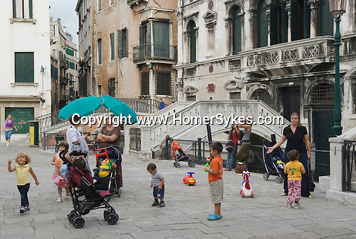 Venice Italy 2009. Families out with children Campo San Maria Formosa. Venetians daily life early evening.
