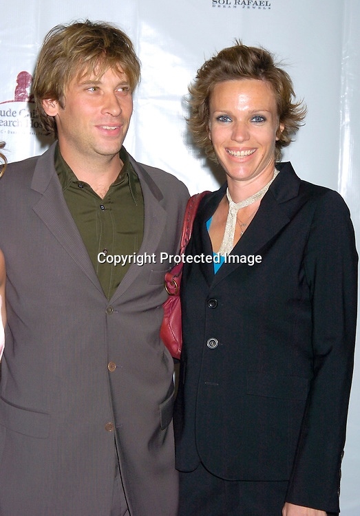 Roger Howarth and wife Cari ..at the 10th Annual Daytime Television Salutes St. Jude Children's Research Hospital Benefit on October 8, 2004 at the Marriott Marquis Hotel in New York City...Photo by Robin Platzer, Twin Images