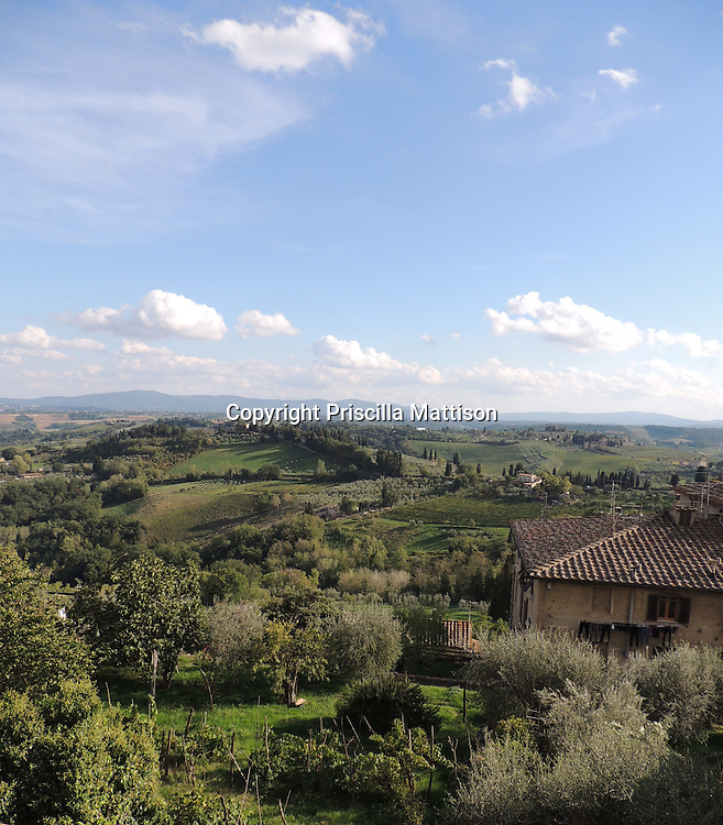 San Gimignano, Italy - October 4, 2012:  The Tuscan countryside spreads out below San Gimignano.