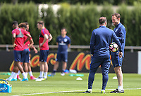 Gareth Southgate, England Manager chats with his assistant Steve Holland during an open England football team training session at Stade Omnisport, Croissy sur Seine, France  on 12 June 2017 ahead of England's friendly International game against France on 13 June 2017. Photo by David Horn/PRiME Media Images.