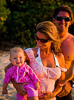 Happy family on the beach at Sunset Beach on the North Shore of Oahu, Hawaii