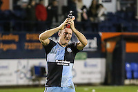 Garry Thompson of Wycombe Wanderers applauds the travelling fans after the Sky Bet League 2 match between Luton Town and Wycombe Wanderers at Kenilworth Road, Luton, England on 26 December 2015. Photo by David Horn.