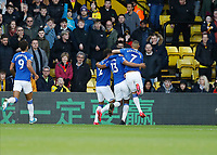 1st February 2020; Vicarage Road, Watford, Hertfordshire, England; English Premier League Football, Watford versus Everton; Yerry Mina of Everton celebrates with Mason Holgate and Richarlison of Everton after scoring his sides 2nd goal in the 46th minute to make it 2-2