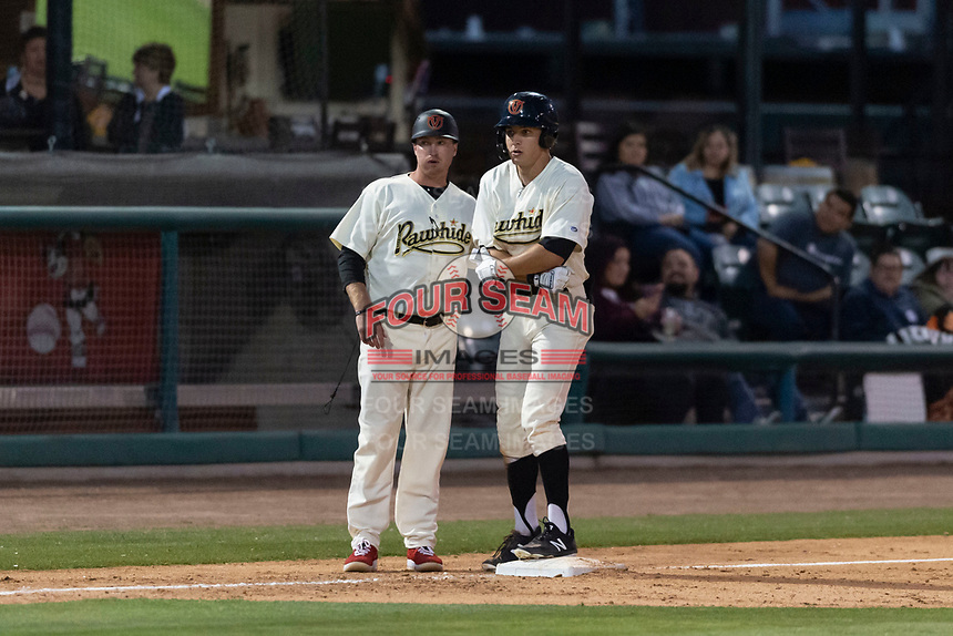 Visalia Rawhide center fielder Jake McCarthy (31) talks to manager Shawn Roof (4) after hitting his second triple of the night during a California League game against the Rancho Cucamonga Quakes on April 9, 2019 in Visalia, California. Visalia defeated Rancho Cucamonga 8-5. (Zachary Lucy/Four Seam Images)