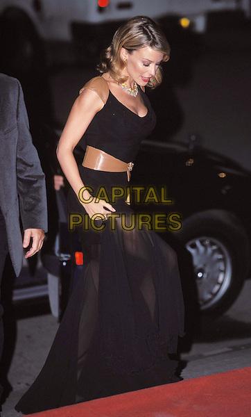 KYLIE MINOGUE..ref: 11033..black dress, tan leather belt, tan leather shoulder straps, leaving car, full length..sales@capitalpictures.com..www.capitalpictures.com..(BD090)