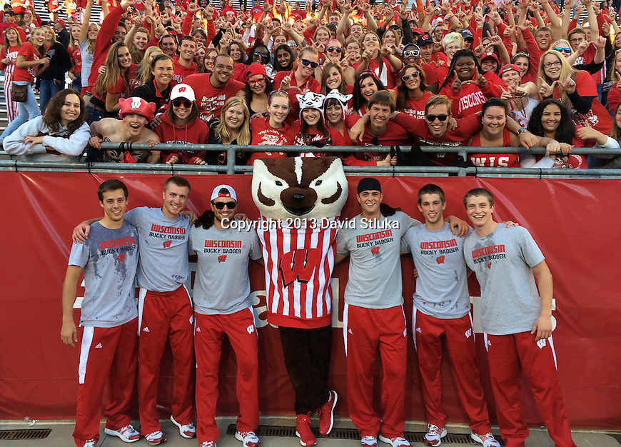 Wisconsin Badgers mascot Bucky Badger and his crew pose with fans after an NCAA Big Ten Conference football game against the Purdue Boilermakers on Saturday, September 21, 2013, in Madison, Wis. The Badgers won 41-10. (Photo by David Stluka)