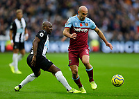 2nd November 2019; London Stadium, London, England; English Premier League Football, West Ham United versus Newcastle United; Jetro Willems of Newcastle United challenges Pablo Zabaleta of West Ham United  - Strictly Editorial Use Only. No use with unauthorized audio, video, data, fixture lists, club/league logos or 'live' services. Online in-match use limited to 120 images, no video emulation. No use in betting, games or single club/league/player publications