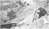 This shot appears to be after RPO #121 was disentangled from Combine #242, with 242 plunging to the bottom of the arroyo.<br /> D&amp;RGW  Barranca Hill, NM  7/17/1929
