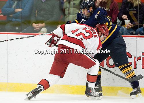 Colin Moore (Harvard - 12), ? - The Harvard University Crimson and Quinnipiac University Bobcats played to a 2-2 tie on Saturday, November 5, 2011, at Bright Hockey Center in Cambridge, Massachusetts.