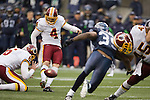 Washington Redskins kicker  Graham Gano has a field goal blocked by Seattle Seahawks Red Bryant in the third quarter at  CenturyLink Field in Seattle, Washington on November 27, 2011. Redskins stunned the Seattle Seahawks 23-17. ©2011 Jim Bryant Photo. All Rights Reserved.