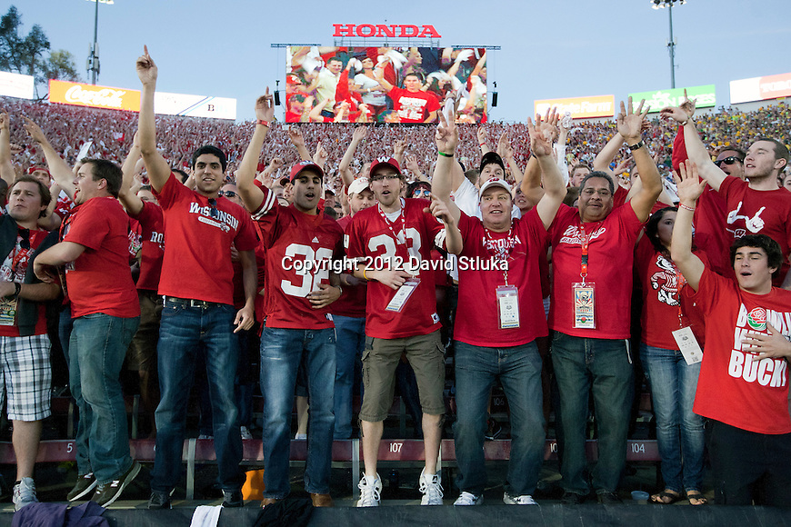 """Wisconsin Badgers fans dance to the song """"Jump Around"""" after the 3rd quarter during the 2012 Rose Bowl NCAA football game against the Oregon Ducks in Pasadena, California on January 2, 2012. The Ducks won 45-38. (Photo by David Stluka)"""