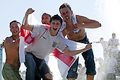 England 1 - Paraguay 0. England fans celebrate the victory over Paraquay in the opening group match in the Football World Cup 2006 with a bath in the fountains of Trafalgar Square.