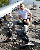 After an intensive workout former Marine sergeant Rob Jones prepares to reattach his bionic legs Wednesday July, 25, 2012 on a dock on the Rivanna River in Charlottesville, VA. Former Marine sergeant Jones, who lost both legs during an IED explosion in Afghanistan, will compete as a rower at the 2012 Paralympics in London, England. Rowing will make its appearance at the London Paralympic Games for only the second time, after its introduction at the Beijing 2008 Games. Photo/Andrew Shurtleff