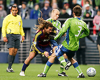 Seattle Sounders Midfielder Freddie Ljungberg (10) and Midfielder Brad Evans (3) fight to win the ball from Real Salt Lake Midfielder Kyle Beckerman (5) in the Seattle Sounders 2-0 win over Real Salt Lake, March 28, 2009 at Qwest Field in Seattle, Washington. Photo by Eric Salsbery/isiphotos.com