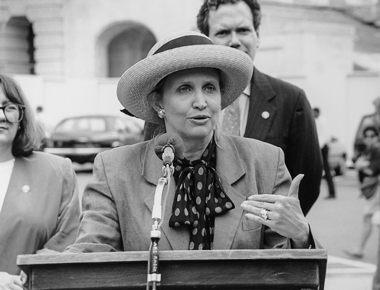 Rep. Carolyn Maloney, D-N.Y., (with hat), Rep. Ken Bentsen, D-Tex., and Rep. Lynn N. Rivers, D-Mich., on Code of Federal Regulations, on June 13, 1995. (Photo by Gigi Goshko/CQ Roll Call via Getty Images)