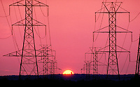 High Tension Electrical Power Lines and the Setting Sun, New Jersey. New Jersey USA suburbia.