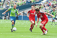 Fredy Ljungberg (L) of the Seattle Sounders drives up the field against Sam Cronin (C) and Jim Brennan (11) of Toronto FC in the match at the XBox Pitch at Quest Field on August 29, 2009. The Sounders and Toronto played to a 0-0 draw.