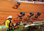 Ukrainian team pursuit riders are passed by their Italian rivals after they crashed out of the final of the The World Championships in Perth.