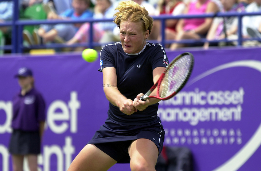 Photo. Rene Solari..19/6/01  .Eastbourne Day 2. .Elena Baltacha shows her aggression during during her defeat in the 1st round against Spanish Conchita Martinez....