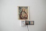 A picture of Jesus Christ is seen on the wall of a room inhabited by Iraqi Christian refugees from Mosul in Hamdaniyah, Iraq.