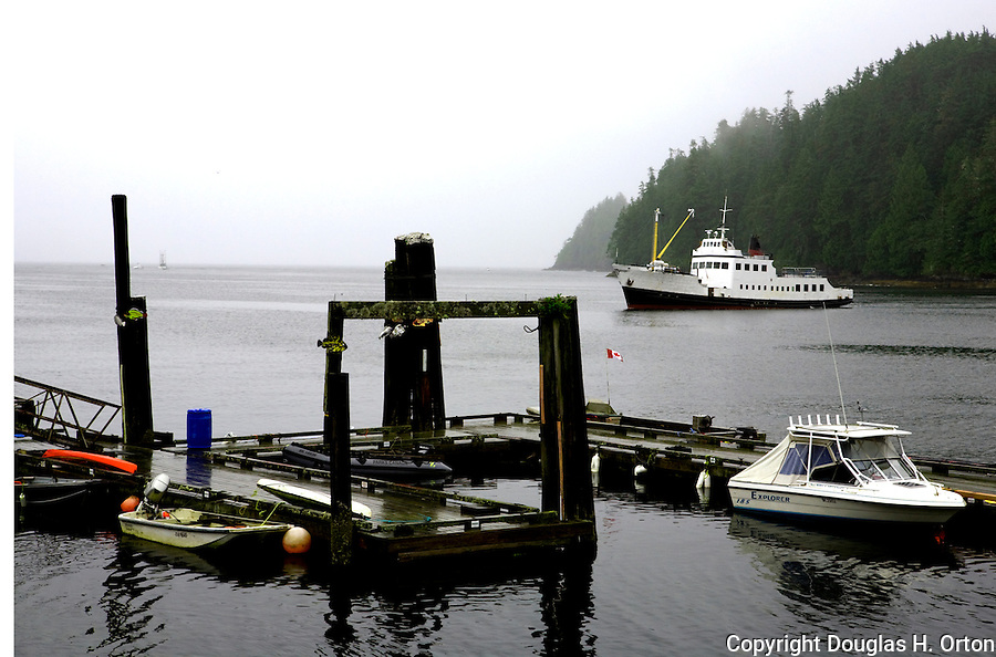 The pocket freighter M.V. Frances Barkley returns to the waterfront of the fishing village of Bamfield, located on the south side of Albernie Inlet, Vancouver Island, British Columbia, Canada.  Bordering one unit of Canada's Pacific Rim National Park and surrounded by rain forest.