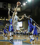 SIOUX FALLS, SD - NOVEMBER 30:  Keaton Moffitt #12 from South Dakota State University takes the ball to the basket past Bernard Thompson #2 and Marc-Eddy Norelia #25 from Florida Gulf Coast in the second half of their game Sunday afternoon at the Sanford Pentagon in Sioux Falls. (Photo by Dave Eggen/inertia)