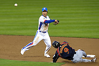 17 March 2009: #16 Ki Hyuk Park of Korea turns the double play against #9 Michihro Ogasawara of Japan during the 2009 World Baseball Classic Pool 1 game 4 at Petco Park in San Diego, California, USA. Korea wins 4-1 over Japan.