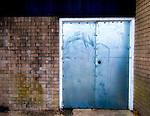 Derelict metal double doors