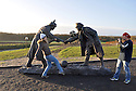 25/12/14<br /> <br /> People play football by a sculpture depicting two WW1 soldiers playing football during the famous Christmas Day truce in the field near Messine, Belgium, close to where the match was played in Flanders, Belgium.<br /> <br /> The sculpture, made in England, arrived in Flanders on Christmas Eve, and was first displayed in the town centre before being taken to the spot where the match was played. <br /> <br /> Sculpted by Andy Edwards the work is entitled &lsquo;All Together Now&rsquo;, recalling the song by the band The Farm - which was inspired by the truce. <br /> <br /> Chris Butler said: &ldquo;Castle Fine Arts are proud to have cast a number of war memorials over the years. We are honoured to support this sculpture for peace. I believe it will touch the hearts of millions.&rdquo;<br /> <br /> <br /> &ldquo;It will be a symbol of peace and hope and a call for a renewed worldwide cessation of violence in honour of those brave boys who &lsquo;joined together and decided not to fight&rsquo;&rdquo;.<br /> <br /> <br /> The statue depicts the meeting of a British and a German soldier over a football, deep in the mud between the lines on that first Christmas of the war. The soldiers appear to be shaking hands but  are not not quite touching, forming a space in which a visitor can insert their own hand to complete the union.  A chance for a moments reflection on how far we are from true peace and brotherhood and the part each of us has to play in that dream. We want the work to stand as both a celebration of this inspirational and heroic event and as symbol of hope and peace. <br /> <br /> The project was instigated some years ago, with the support of the Football Asscociation (FA), as football&rsquo;s contribution to the First World War commemorations. <br /> <br /> All Rights Reserved - F Stop Press. www.fstoppress.com. Tel: +44 (0)1335 300098