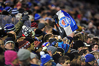 A Bath fan in the crowd waves a flag in support. European Rugby Champions Cup match, between Bath Rugby and Montpellier on December 12, 2014 at the Recreation Ground in Bath, England. Photo by: Patrick Khachfe / Onside Images