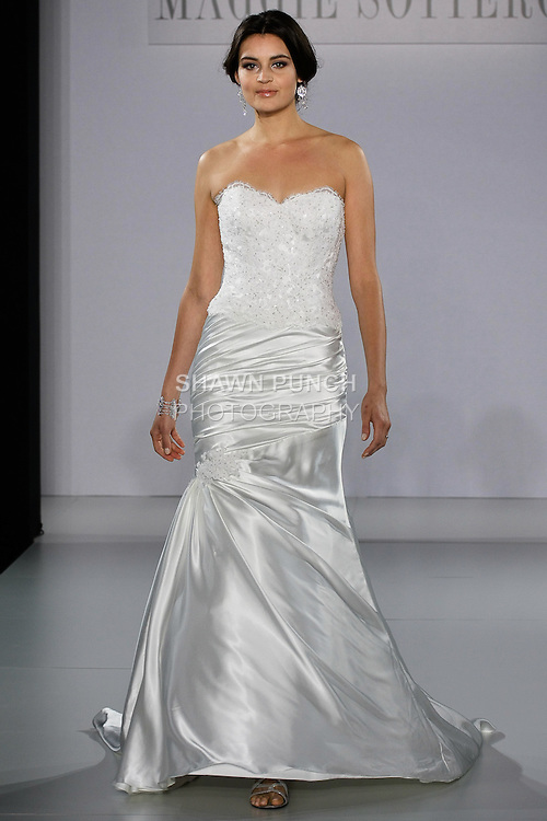 Model walks runway in a Tristan wedding gown from the Maggie Sottero Spring 2013 collection, at The Couture Show, during New York Bridal Fashion Week, on October 14, 2012.