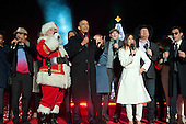 """United States President Barack Obama sings """"Jingle Bells"""" as he and the First Family attend the National Christmas Tree Lighting on the Ellipse in Washington, DC on Thursday, December 1, 2016.  From left to right: Chance the Rapper, Santa Claus, President Obama, Caroline Smedvig, James Tayor, Eve Longoria, Garth Brooks, and Mark Anthony. <br /> Credit: Ron Sachs / Pool via CNP"""