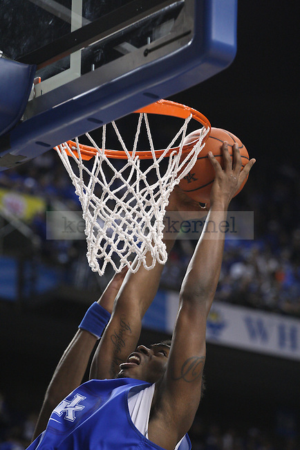 Center Dakari Johnson dunks the ball during the second half of the Blue-White Scrimmage at Rupp Arena on Monday, October 27, 2014 in Lexington, Ky. Photo by Adam Pennavaria | Staff